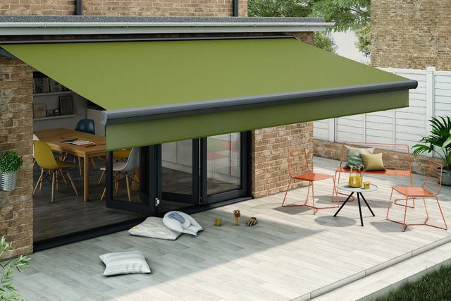 Large dark green awning covering a patio