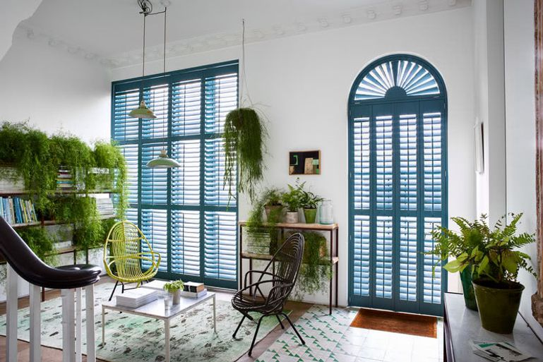 Full height Richmond shutters in a roomset
