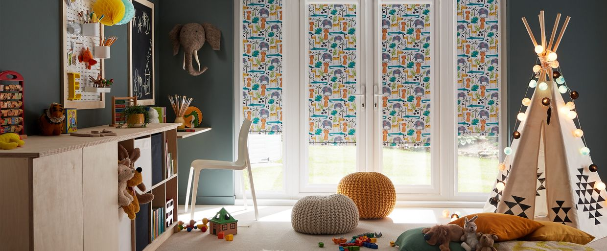 kids playroom with colourful animal print blinds in the window