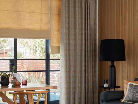 Lindora Gold Roman Blind and Verve Golden Wheat curtains in Dining Room