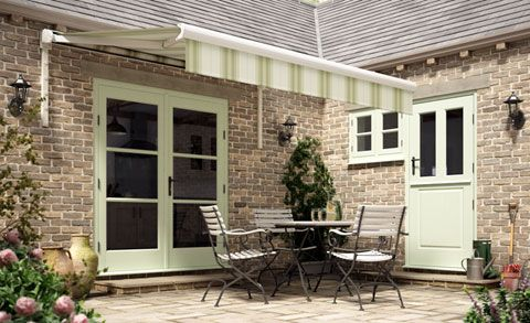 Green garden awning over outdoor seating area
