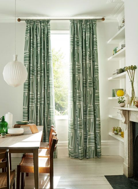 Full length green curtains in modern rustic dining room