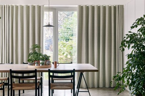 Rustic dining room with wave header full length green curtains