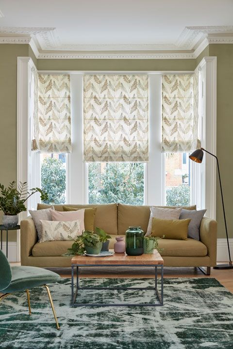 Tonal green living room with leaf motif Roman blinds