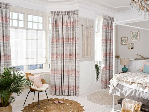 Fjord Coral curtains and Ombre Natural Voile Roman in bedroom