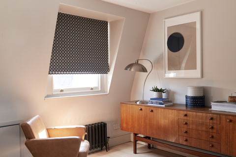 Retro living room with geometric print Roman blind