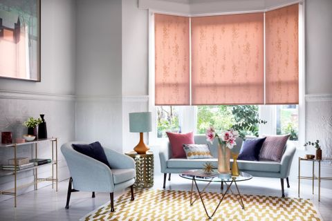 Living room bay window with pink floral Roller blind