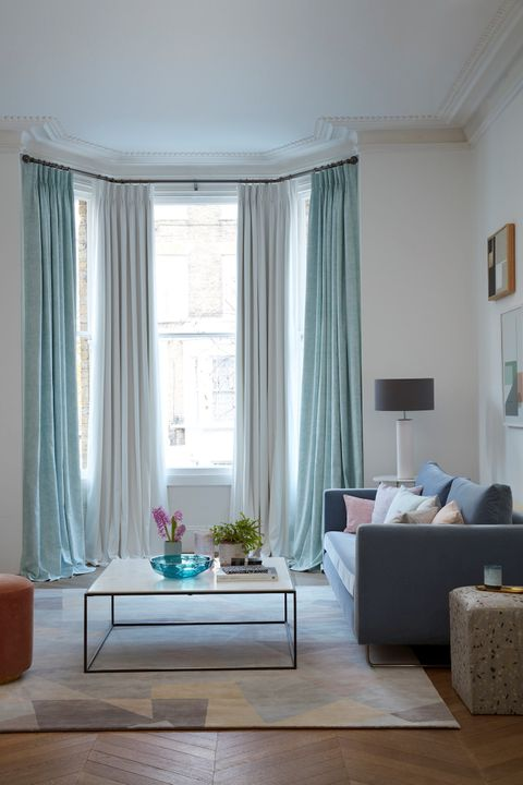 Bay window curtains in blue and white fabrics