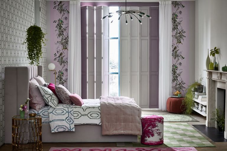 Several neutrallly toned Solid Shutters decorate a bedroom window