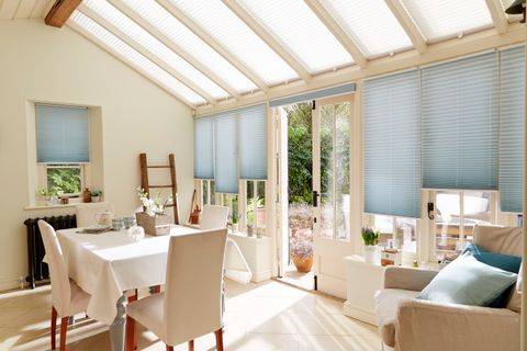 Light and spacious dining area with Aqua Pleated Conservatory Blinds