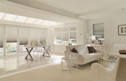 Taupe Pleated Conservatory Blinds in a modern open plan living and dining space