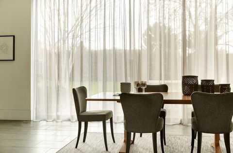 Elegant Dining Area with Sheer Voile Curtains in Serene Stone Fabric
