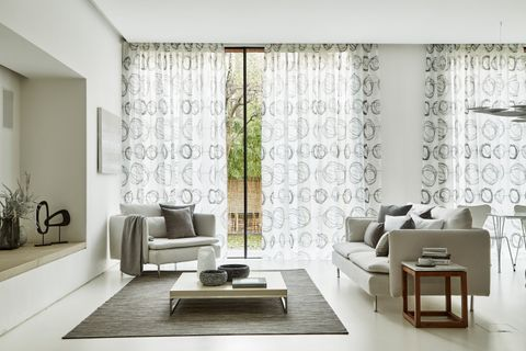 White Interior Living Room with White Patterned Voile Curtains in Swirl Dusk Fabric