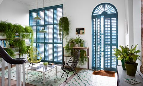 Blue custom colour shaped shutters in hallway