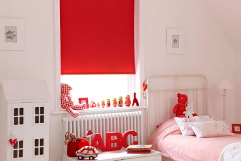 Cordova Crimson roller blind hung in child's bedroom
