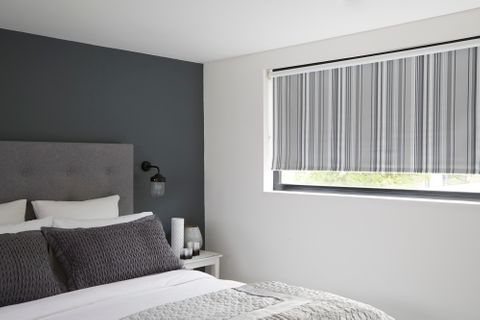 Striped Lester Silver Roller Blind hung in bedroom