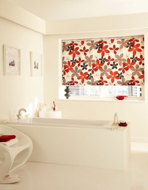 Red floral Tahiti Chilli Roller Blind hung in bathroom