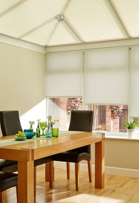 Hexham Stone Roller Blind hanging in conservatory
