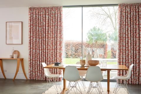 Origami Persimmon Curtains hanging in dining room