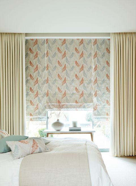 Tranquility Dawn Roman Blinds with Tetbury Ivory Curtains in bedroom