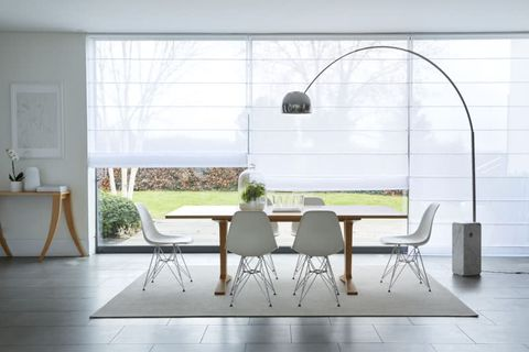 Dining room with white Voile Roman blinds over wide window