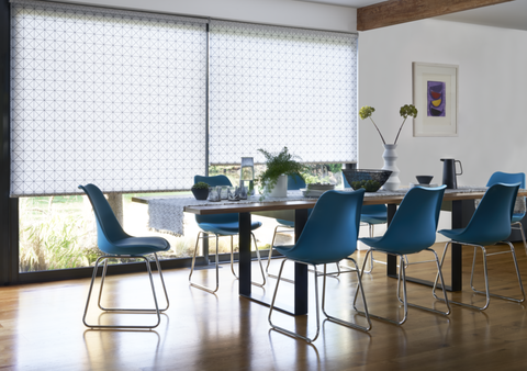 Dining room with geometric print Roller blinds