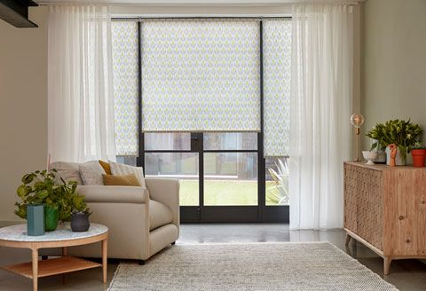 Crittall doors with Voile curtains layered over a floral Roller blind