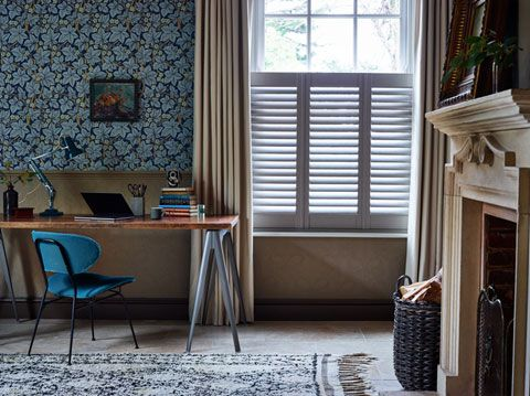 Cafe style shutters layered with full length curtains