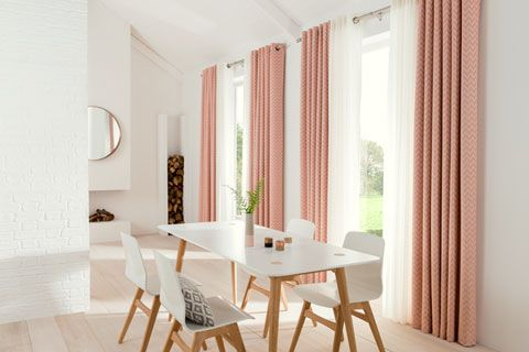 Dining room with coral curtains and sheer voiles
