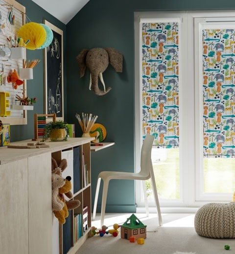Kids playroom with jungle print Roller blinds in PerfectFit frames