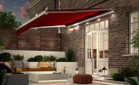 Outdoor entertaining space covered by garden awning