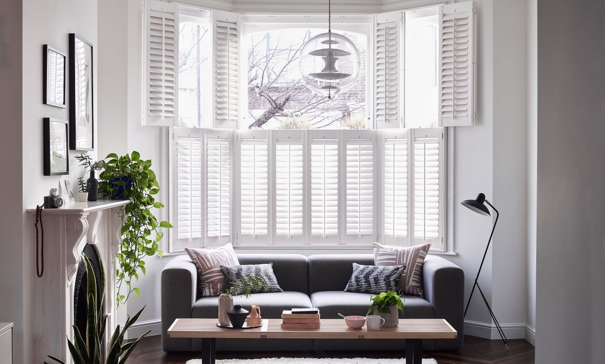 White Windsor Shutters in bay window