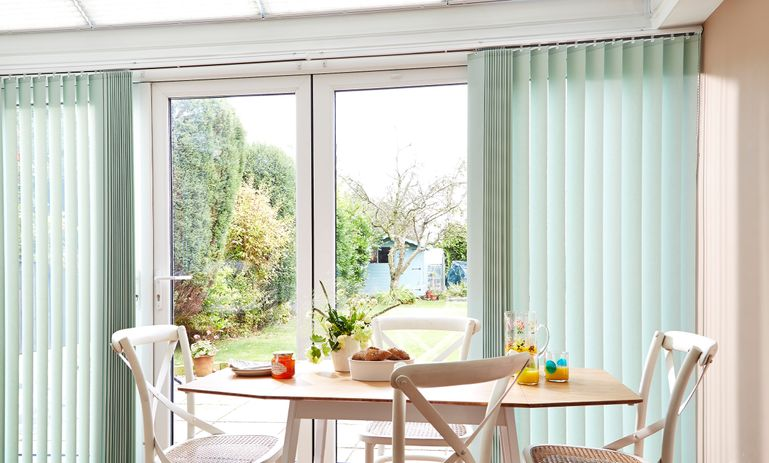 Acacia Fresh Mint Vertical blind in conservatory room