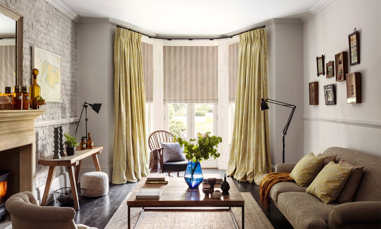 Oralia Ochre curtains and Howard Natural Roman Blind in living room