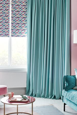 Harlow Turquoise curtains and Jazz Fuchsia roller blinds in living room