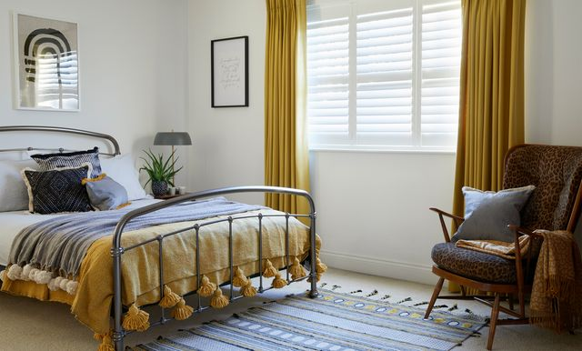 Silk white shutters and Tetbury Mustard curtains in bedroom