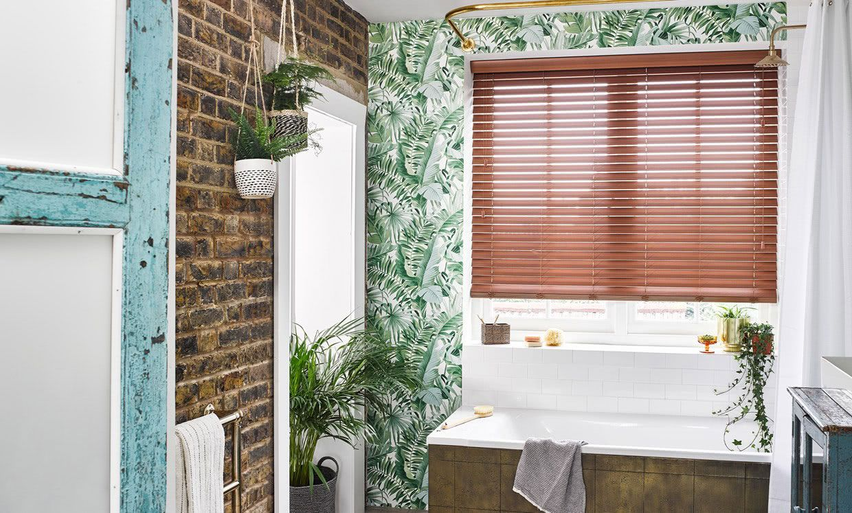 Nutmeg Faux Wood Venetian blinds in Bathroom Window above Bath