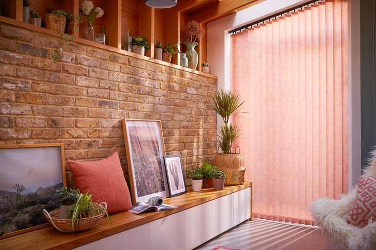 coral vertical blinds in a patio window