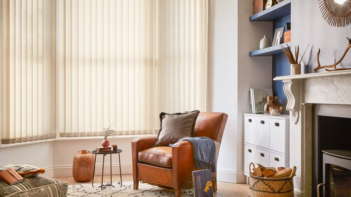 cream  Tweed Wheat vertical blinds in a stylish living room window