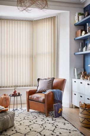 cream vertical blinds in a modern living room window
