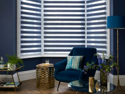 Blue luxe living room with a day and night Roller blind