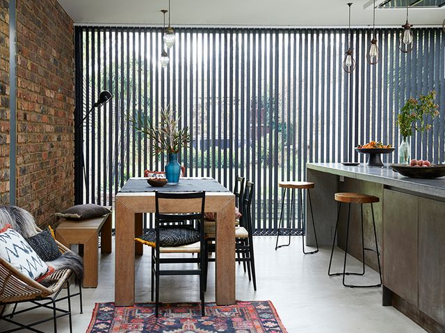 Kitchen with wide glass window, fitted with Acacia Black verticals and Serene Linen Voile curtain