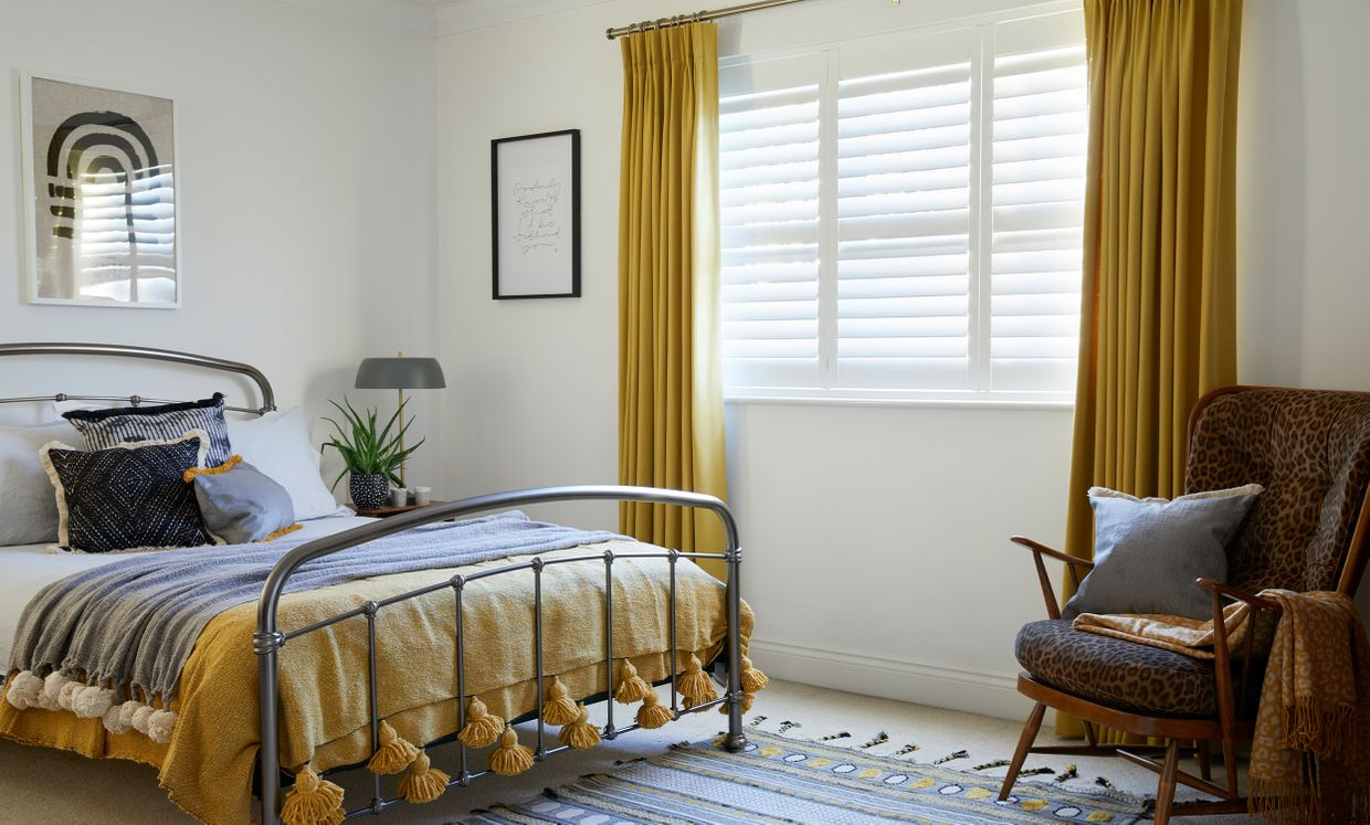 Tetbury Mustard curtains and silk white shutters in bedroom