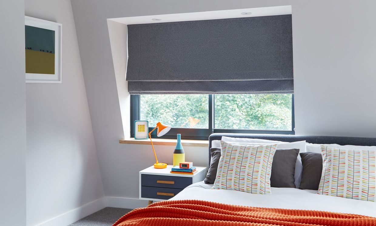 Huxley Charcoal roman blind in bedroom