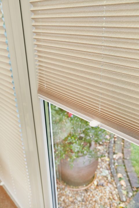 Close up of light beige pleated blinds