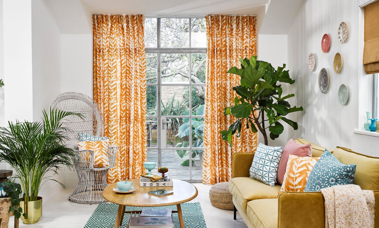 Statement Living Room with Orange Pinch Pleat Curtains in Isra Amber and Colourful Decor