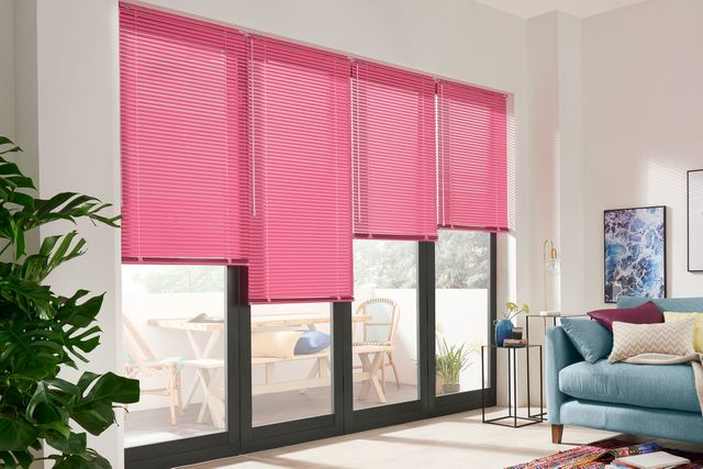 Acacia pink venetian blinds in a living room window