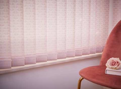 Close up of light pink vertical blinds