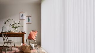 Modern rustic dining room with full length white vertical blinds