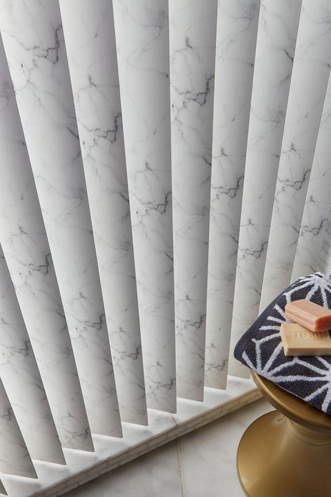 Close up of vertical blinds in a marble effect fabric